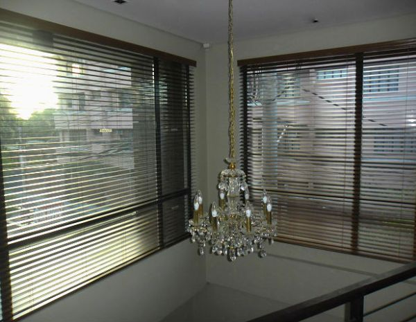 Wood Blinds paired with Pretty Chandelier